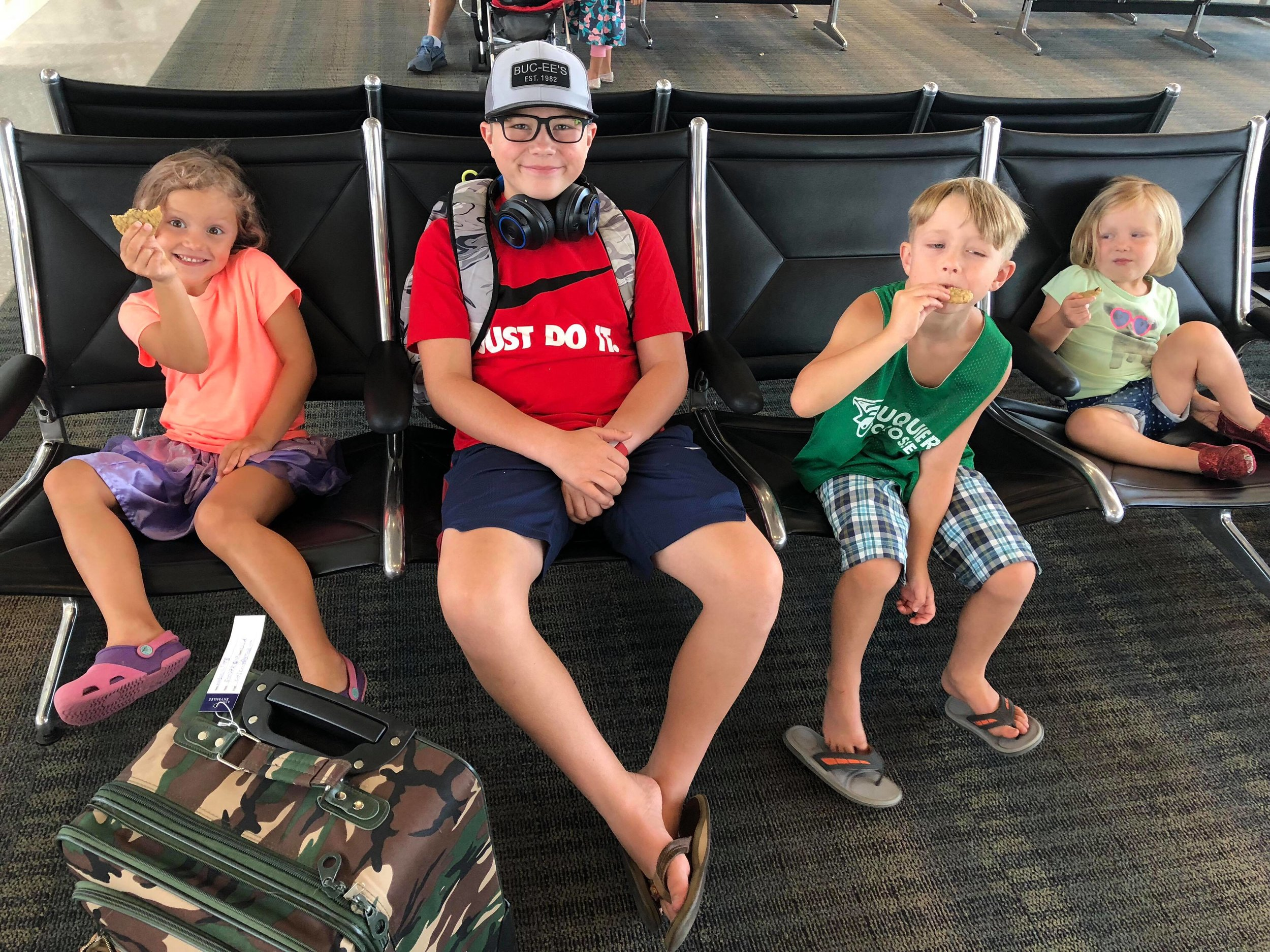 This is Hudson and his siblings waiting at the gate for his flight to see his dad! All the kids got to come sit with him until he took off!