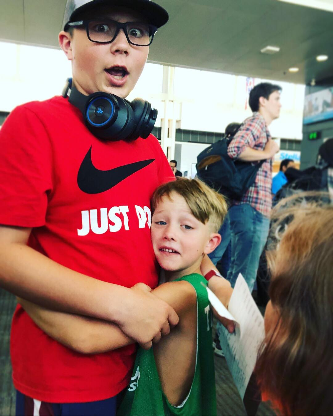 Saying goodbye before Hudson boards his flight! (check out his wrist band!)