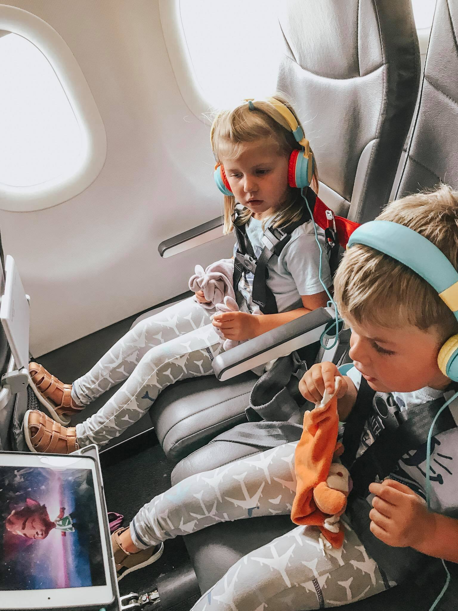 The Kids and the older version of these connecting headphones. Both can watch the same movie because the headphones inter-connect! Also check out their awesome CARES harnesses!