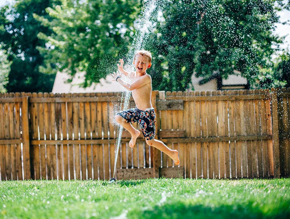 running-through-sprinklers
