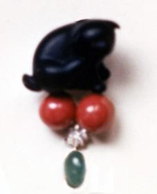 #85 EBONY DOG NETSUKE_ emerald, coral, diamonds .jpg