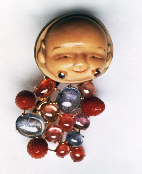 #72 CARVED PIT NETSUKE SMILING FACE _cab. sapphires, coral .jpg