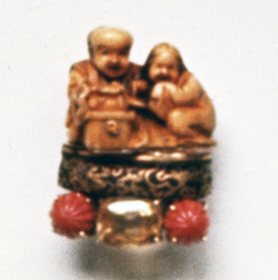 #56 IVORY NETSUKE _ FUCHI  COUPLE_  Ceylon sapphire, carved coral .jpg
