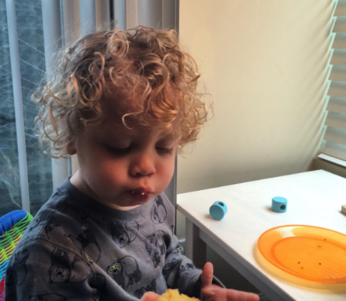 Alex eating one of his favorites,  Orange Almond Cake  when he was two.