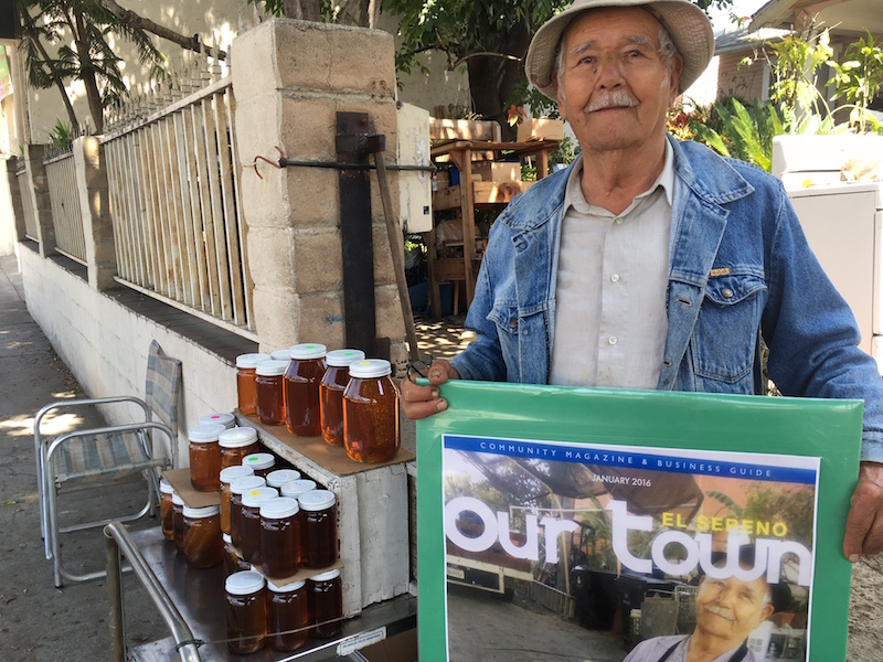 Victor Jaramillo at his honey stand  next door to the El Sereno Library.