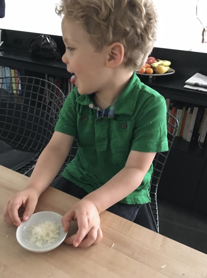 Alex, tasting his ingredient prior to using it. He loves fresh parmesan.