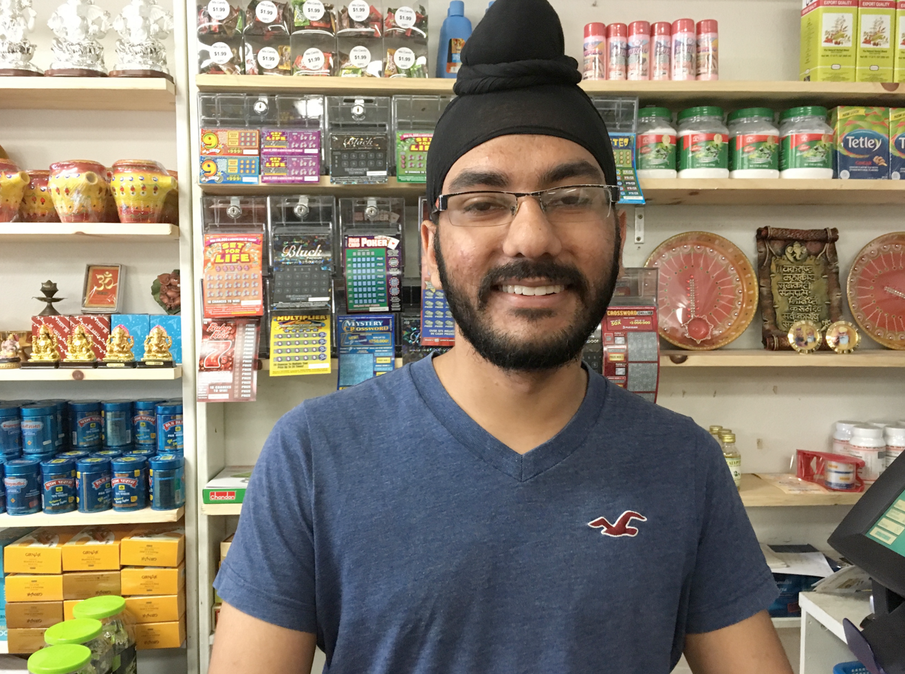 Clerk at Punjab grocery who gave me a tour of all of the spice variations;, whole, ground, and already combined into pre-packaged masalas. He advocated for homemade.