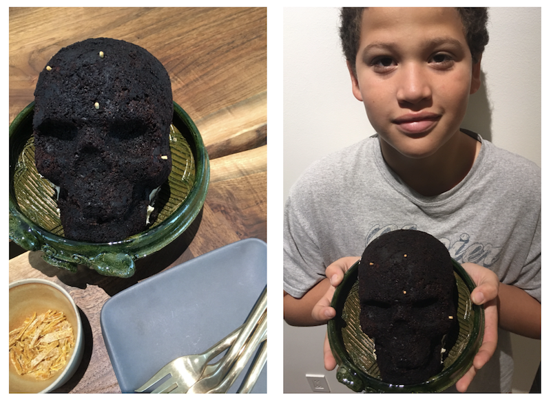 Annual skull cake baking, a Halloween tradition, with grandson Anthony.