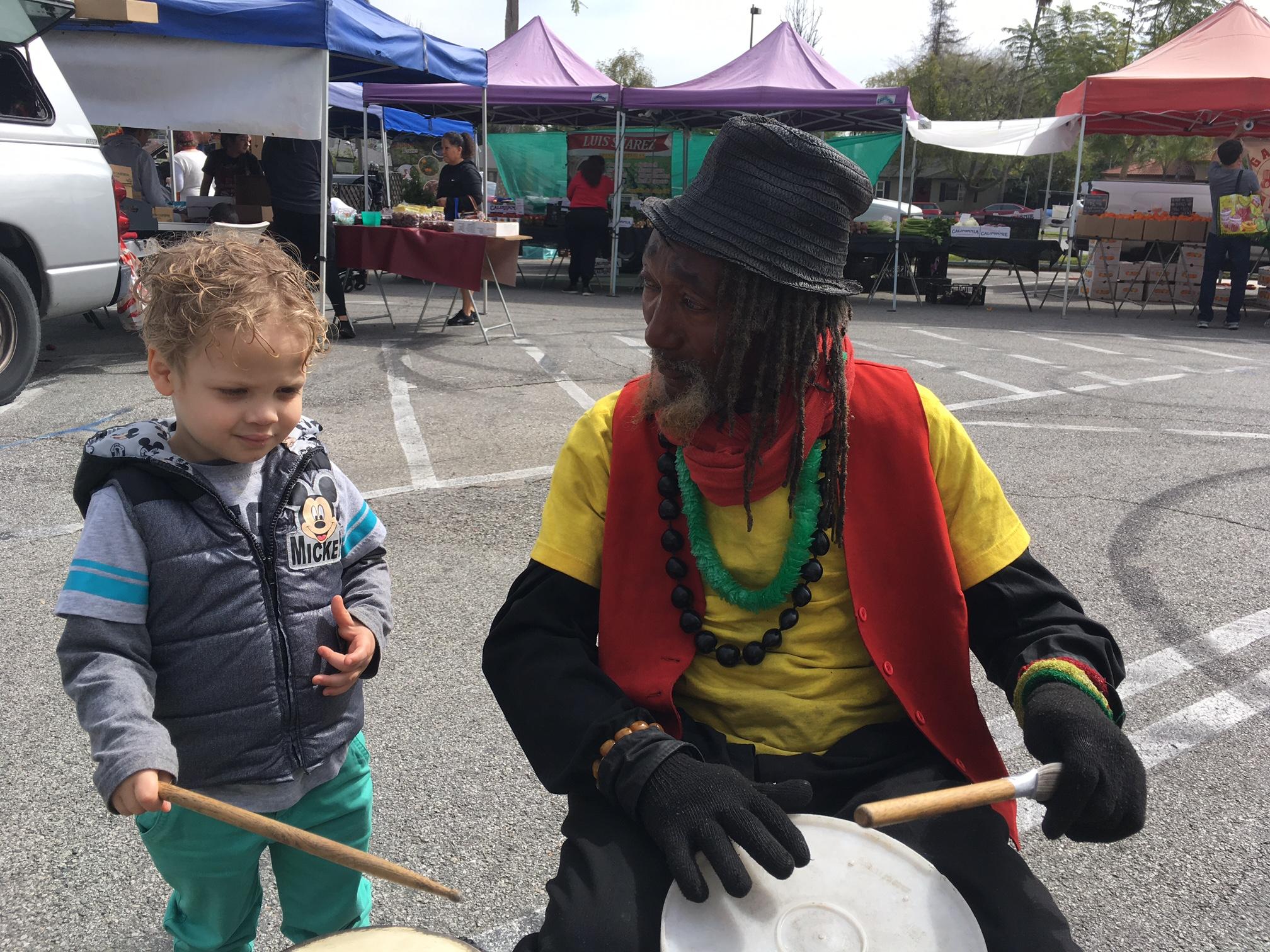 Alex then 3 at the Pasadena Saturday Farmers Market, enjoying the entertainment.