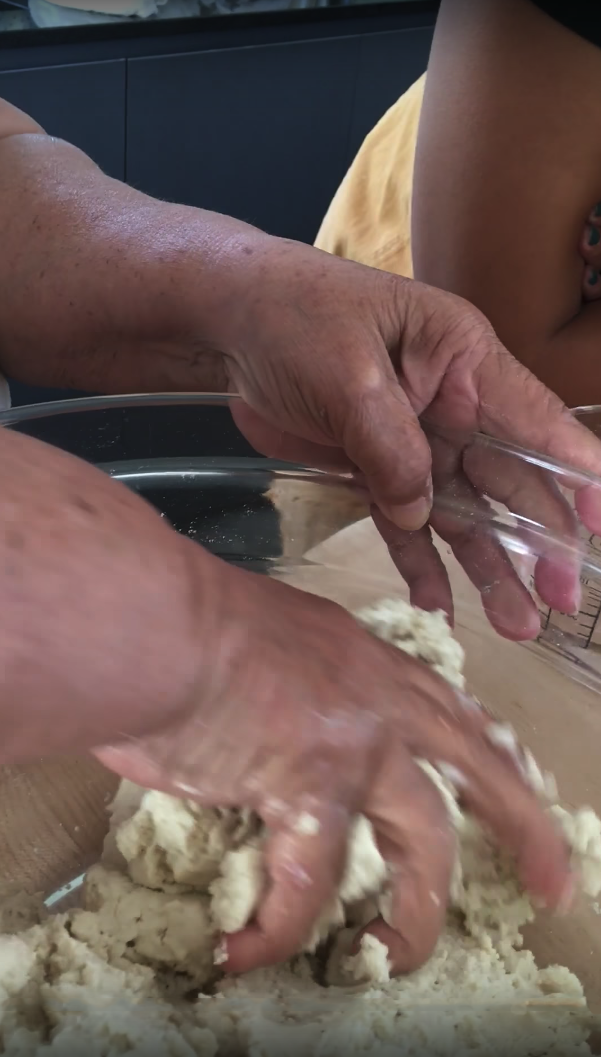 Ophelia Vallecillo making masa.