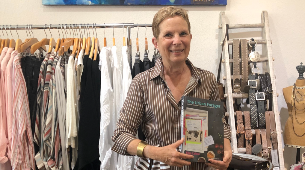 Elisa hanging out at Tuck wearing one of their gorgeous dresses and a cuff with a favorite cookbook.