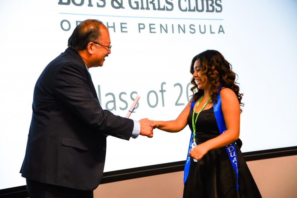 Redwood City Mayor, Jeff Gee, congratulates graduate Crystal V.