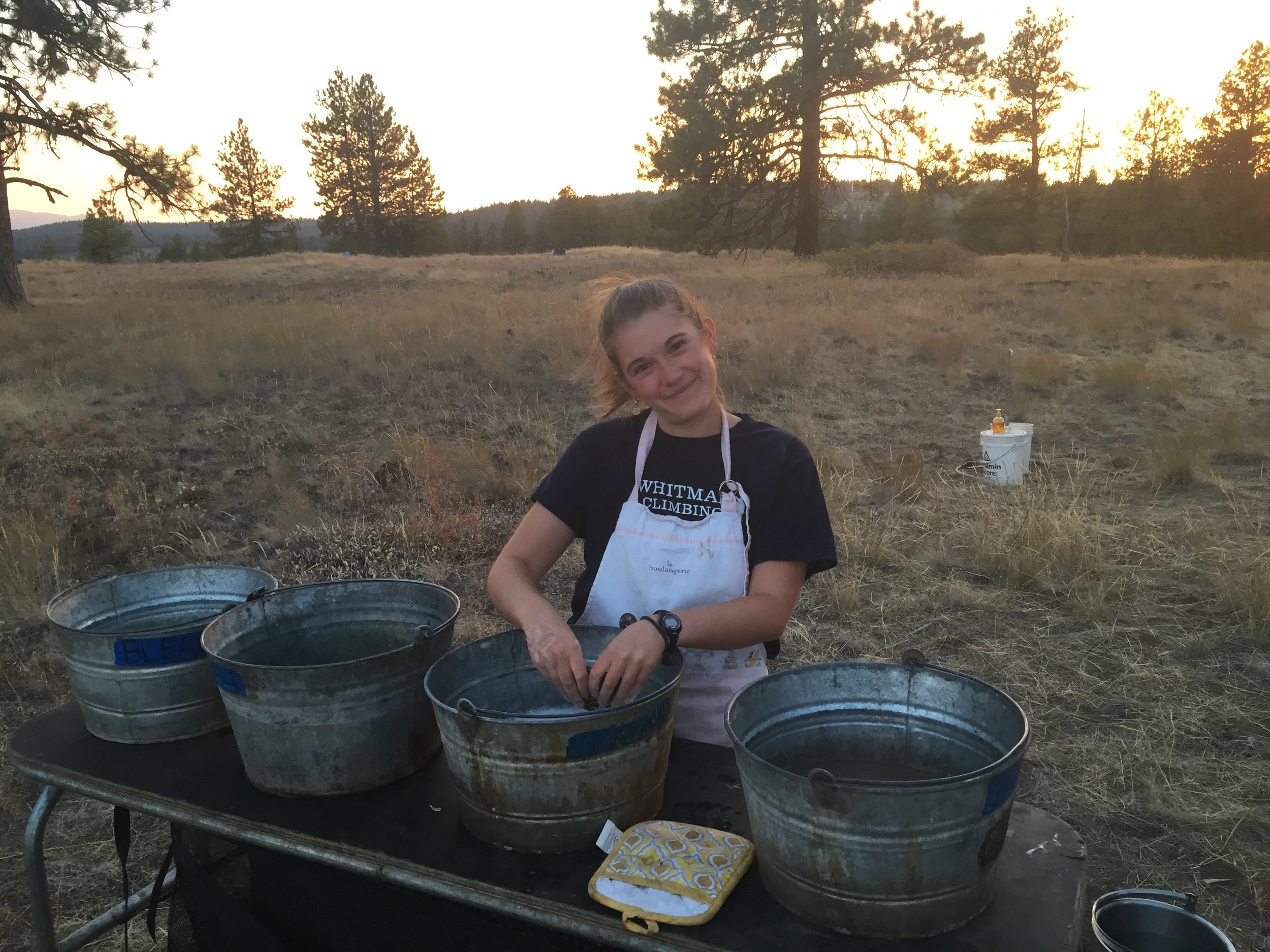 Maggie washing dishes on Starvation Ridge