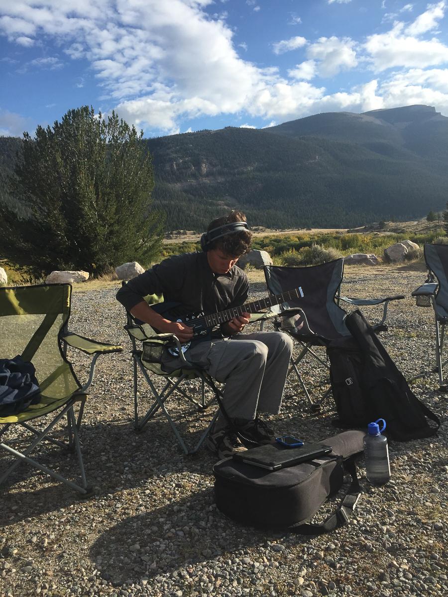 Hunter jams on the electric guitar outside Dubois, WY