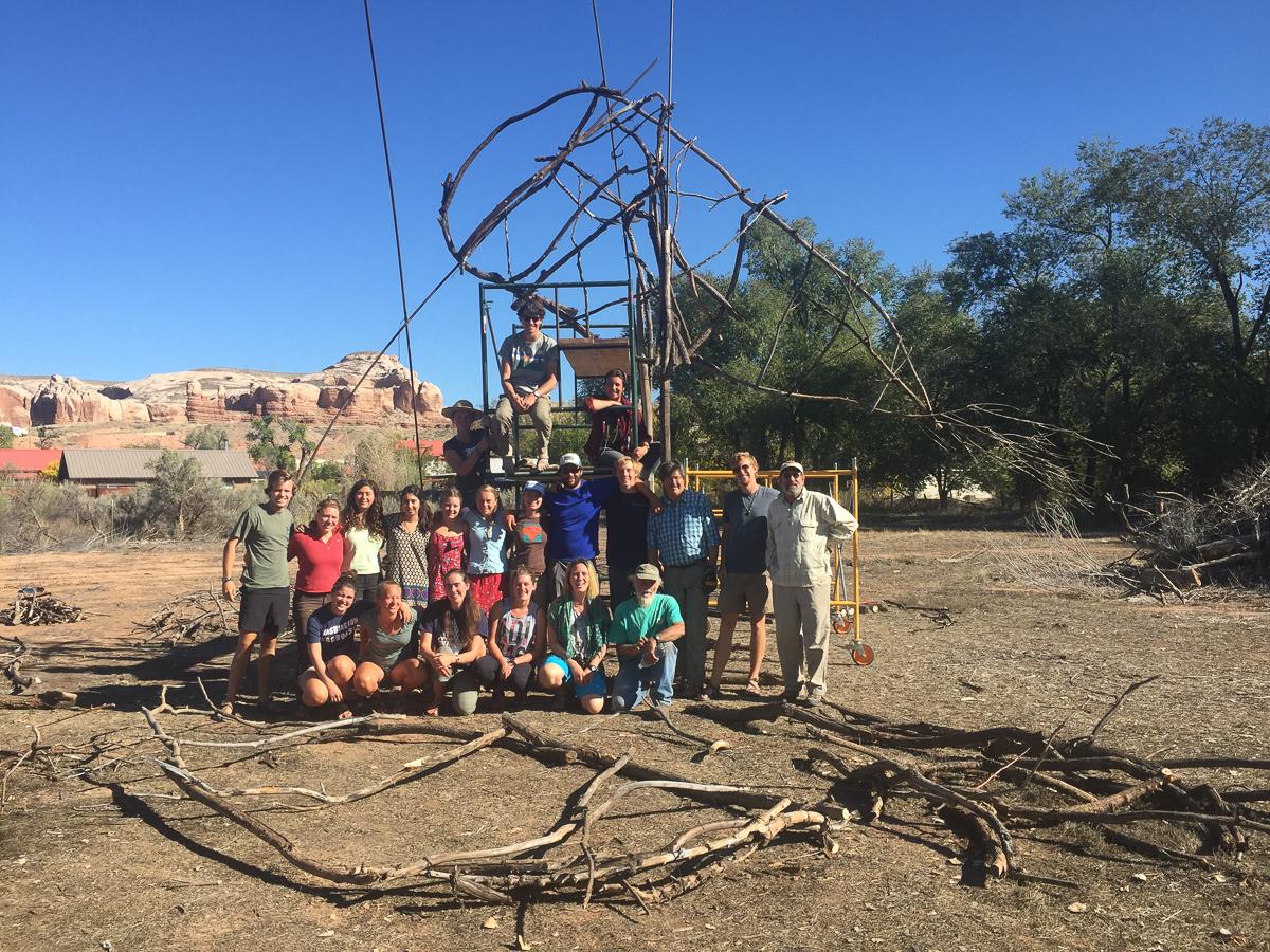 Westies help out Joe Pachak build the Bluff solstice bonfire