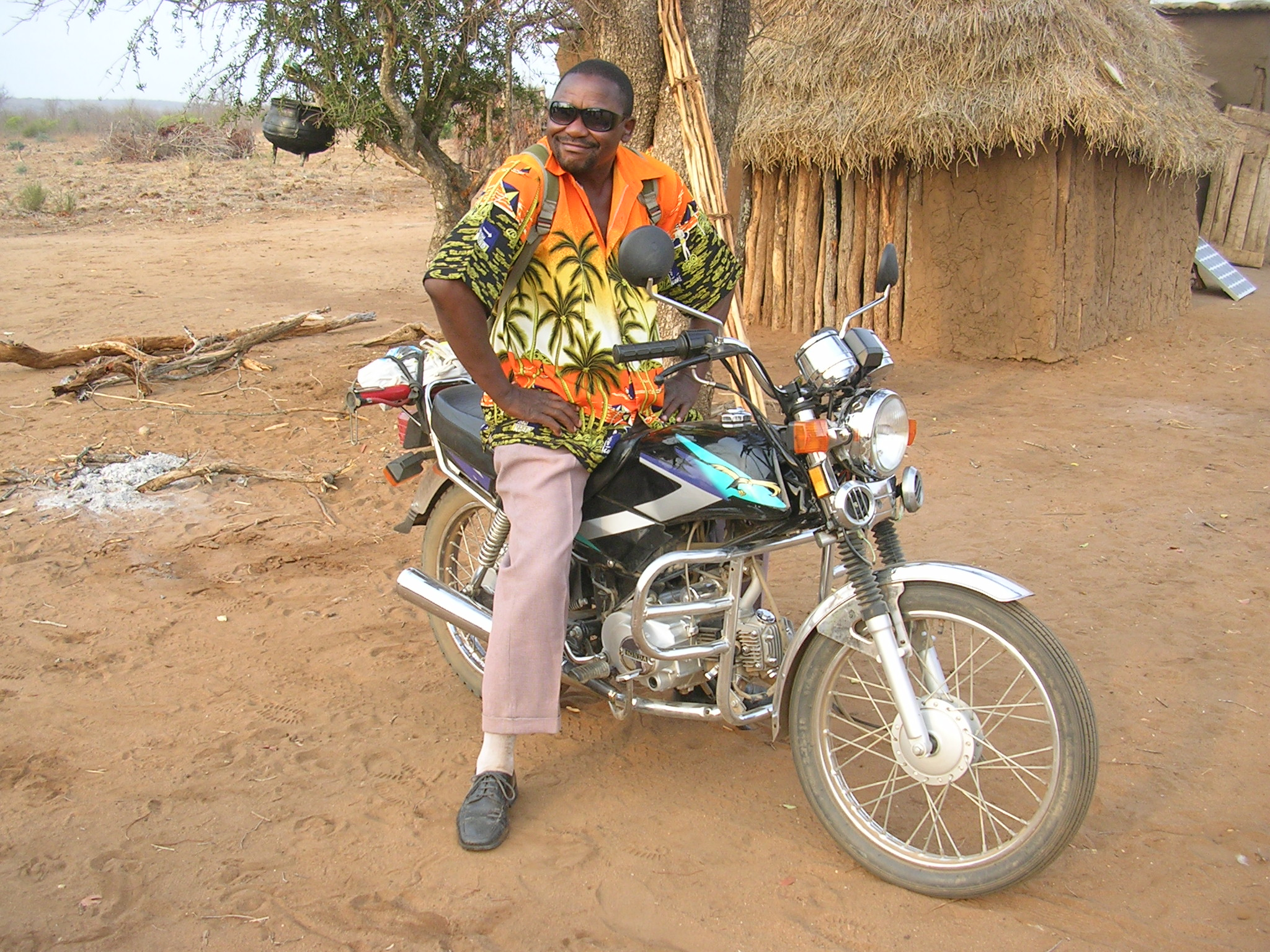 Armando and his motorcycle. As soon as he received the cash compensation for resettlement, he bought this motorcycle.