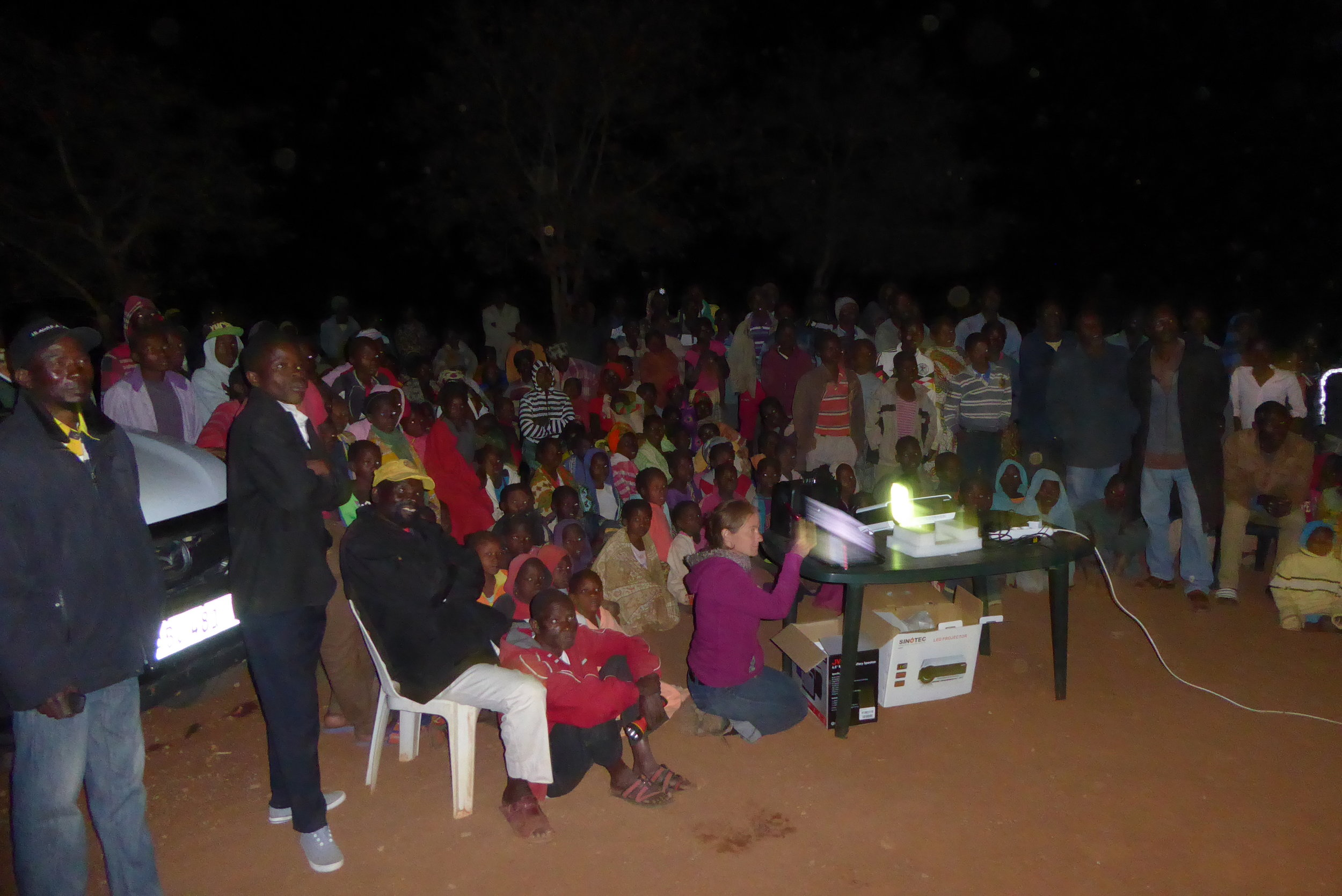 Screening of an early version of ORPHANS OF THE LAND in the resettled village of Macavene.