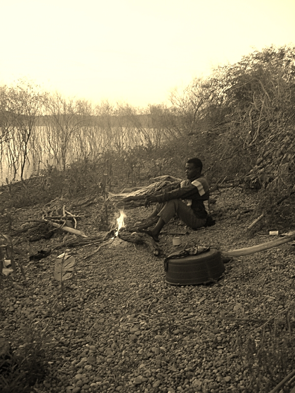 Protecting a small plot of maize grown on residual water along the dam's receding edge from turning into a hippo's dinner (before resettlement, 2007)