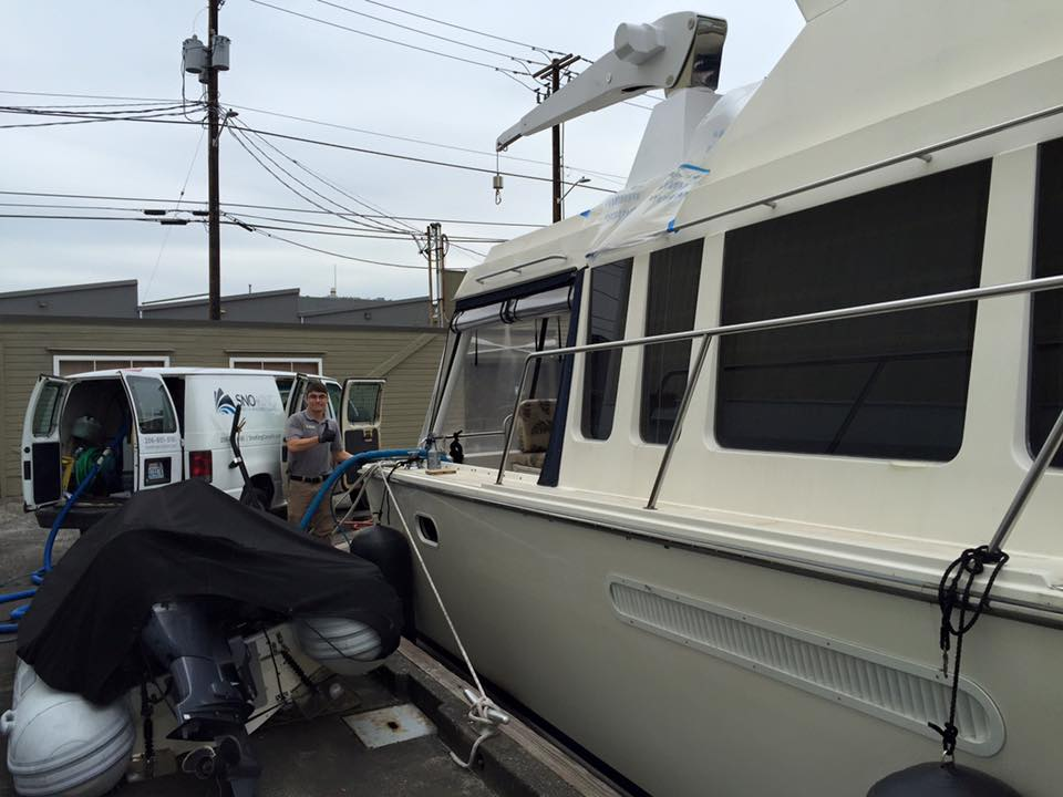 Here's Bill cleaning a boat in Ballard!