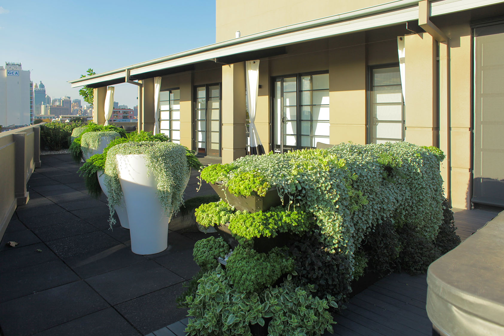 These pots are a great touch to this outdoor space. Very little maintenance when built correct.