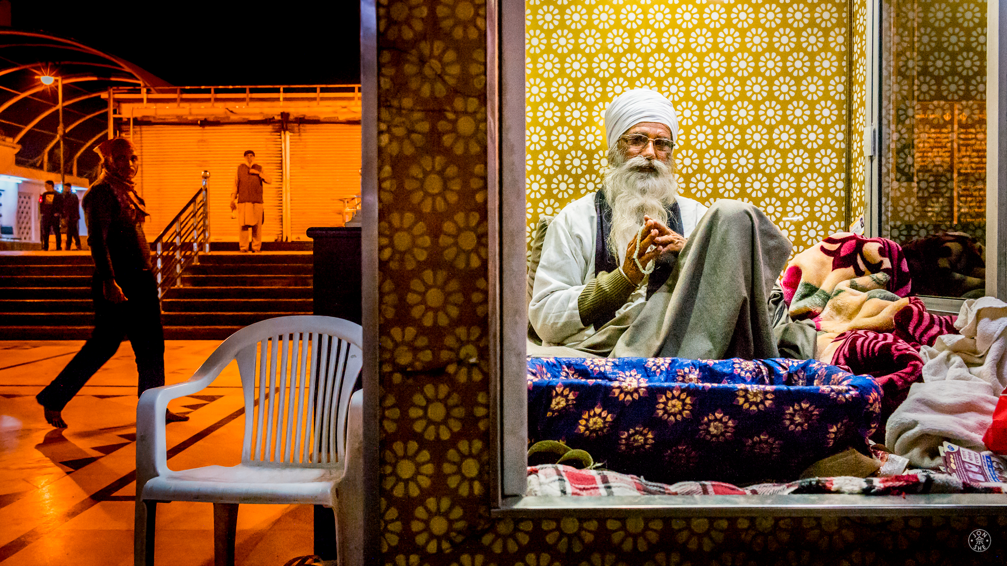 """The Sikh in the Window"".  Outside the Gurudwara Bangla Sahib, Old Delhi, India. January 2017. © Jon She. Leica M10, Leica Summilux 28mm f/1.4 ASPH."