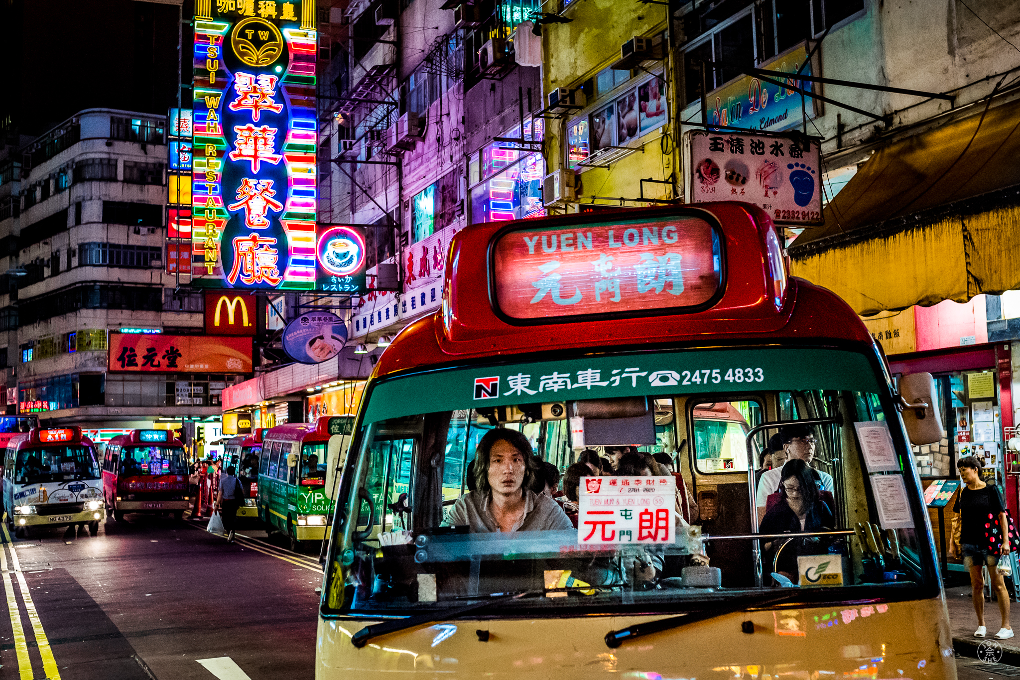 """""""Bus to Yuen Long"""".  I almost got run over by this bus, while standing in the middle of the street in Kowloon. All night these buses ferry Hongkongers to and from the city's urban centers, providing an air-conditioned respite from the mid-year humidity. Kowloon, Hong Kong, China. June 2016. Leica SL (Typ 601), Leica Summilux-M 35mm Aspherical. © Jon She."""