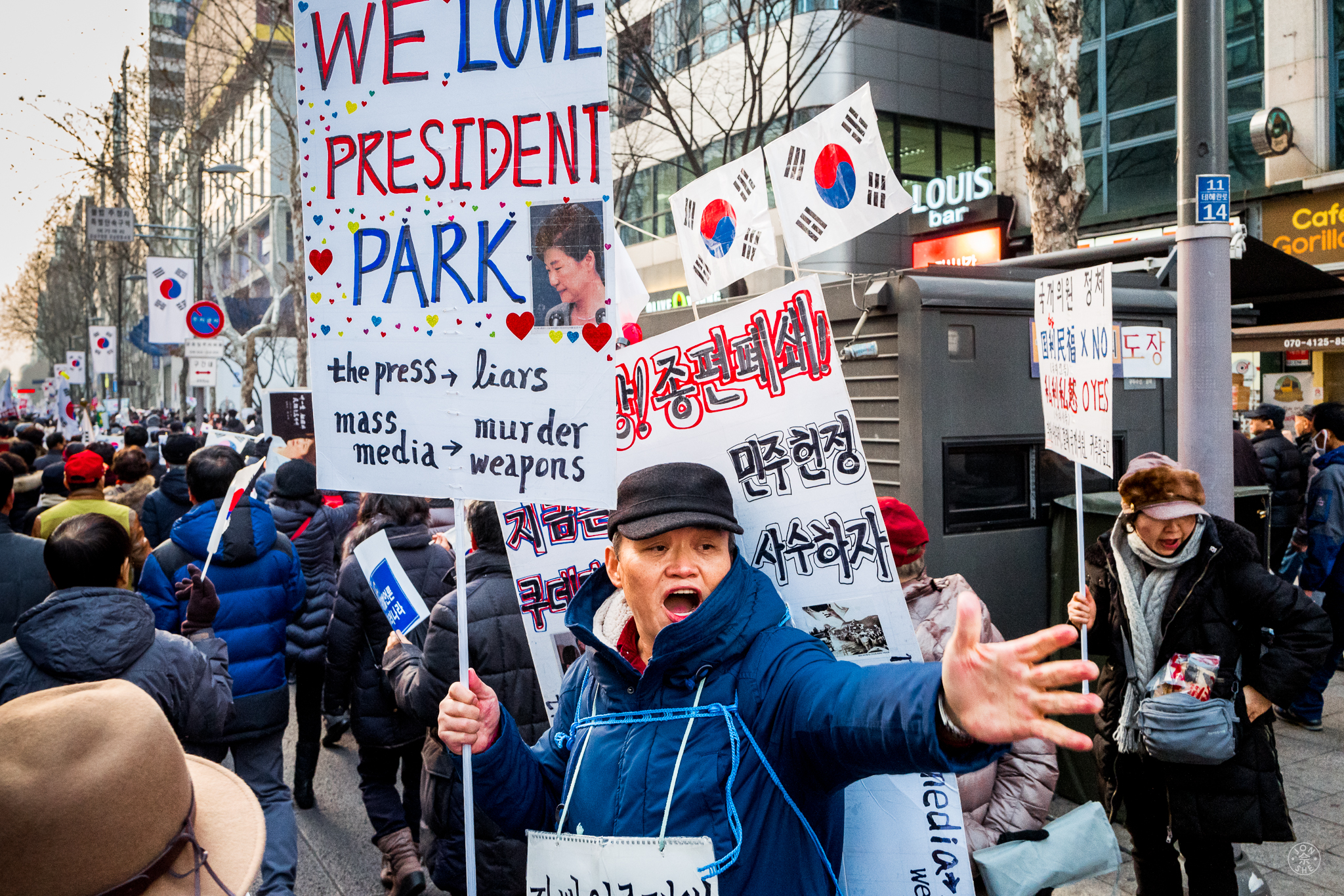 """""""The Contrarian"""".  A supporter of President Park Geun-hye declares his position, in a peaceful demonstration attended by tens of thousands of the republic's citizens in Gangnam, the fashionable district of Seoul. There were demonstrators both for and against President Park to be ousted from office for her alleged role in a corruption scandal. Seoul, South Korea.January 2017. © Jon She.Leica Q (Typ 116), Leica Summilux 28mm f/1.7 ASPH (FLE)."""