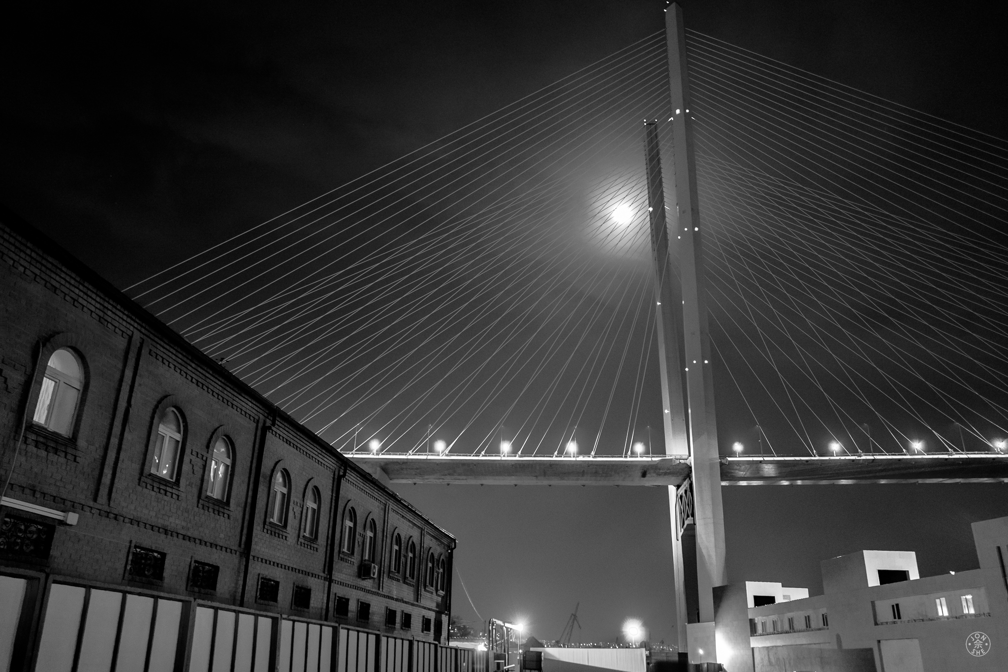 """""""Zolotoy Bridge at Night"""".  Like a geometric Colossus the """"Golden Horn"""" bridge dominates the winter skyline from almost everywhere in the city, linking the old to the new. Vladivostok, Primorsky Krai, Far East Russia. January 2017. © Jon She. Leica Q (Typ 116), Leica Summilux 28mm f/1.7 ASPH (FLE)."""