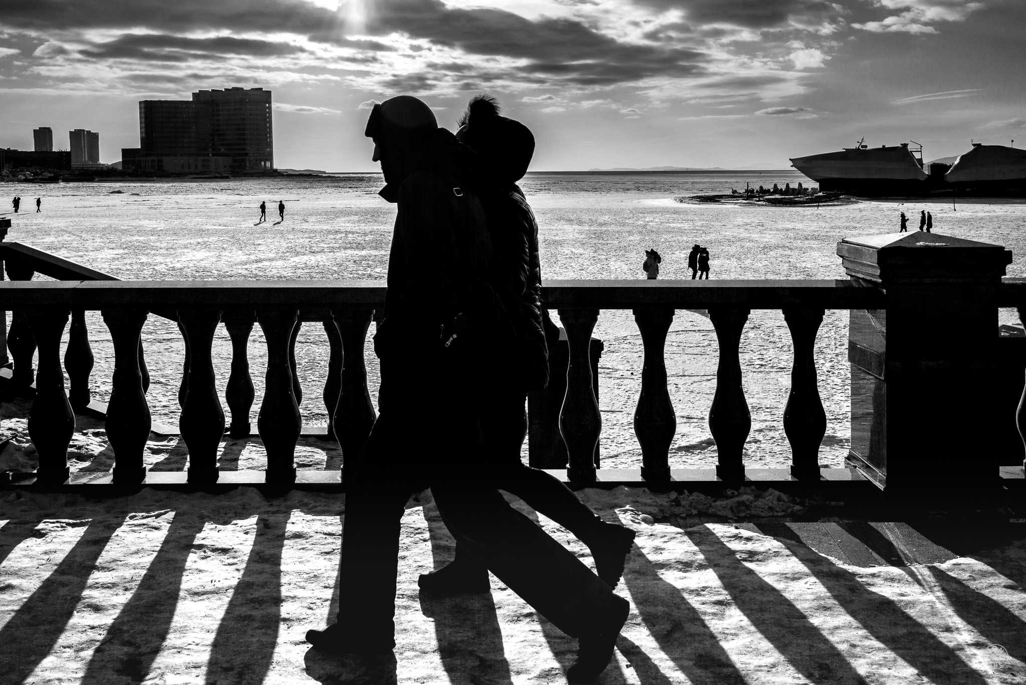 """""""Winter Beach"""". While a very busy spot in summer, in winter the main beach promenade in the city was mostly deserted. There were only a few families out on the frozen sea in the afternoon. Vladivostok, Primorsky Krai, Far East Russia. January 2017. © Jon She. Leica M (Typ 240), Leica Summilux 35mm f/1.4 ASPH (FLE)."""