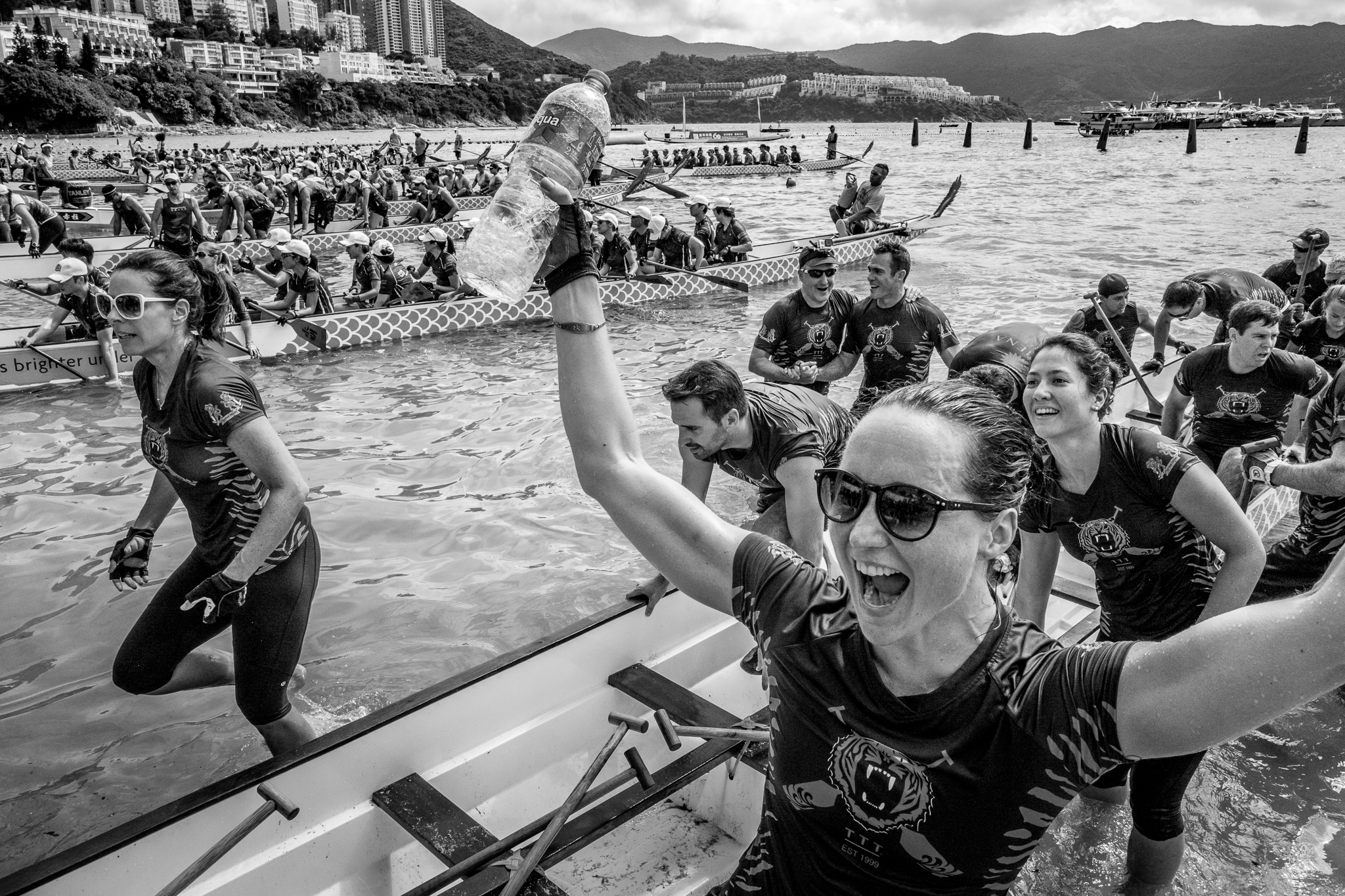 """""""Race End"""".  A Dragonboat Festival Race team arrives back on Stanley Beach after a successful race. Hong Kong, China. June, 2016. © Jon She.Leica Q (Typ 116), Leica Summilux-M 28mm ASPH."""