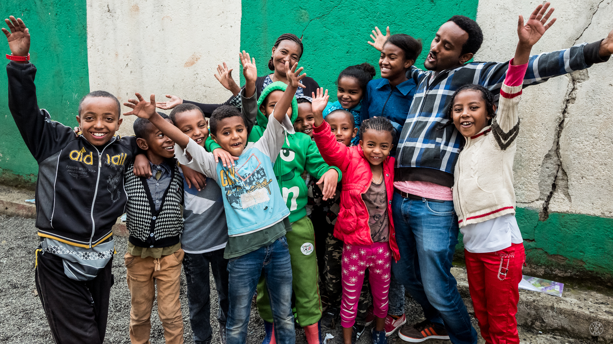 "Amare Terferi of Strong Hearts with some of ""his children"" - these from a special needs tuition class they conduct during the summer school break months. Addis Ababa, Ethiopia. © Jon She 2017."