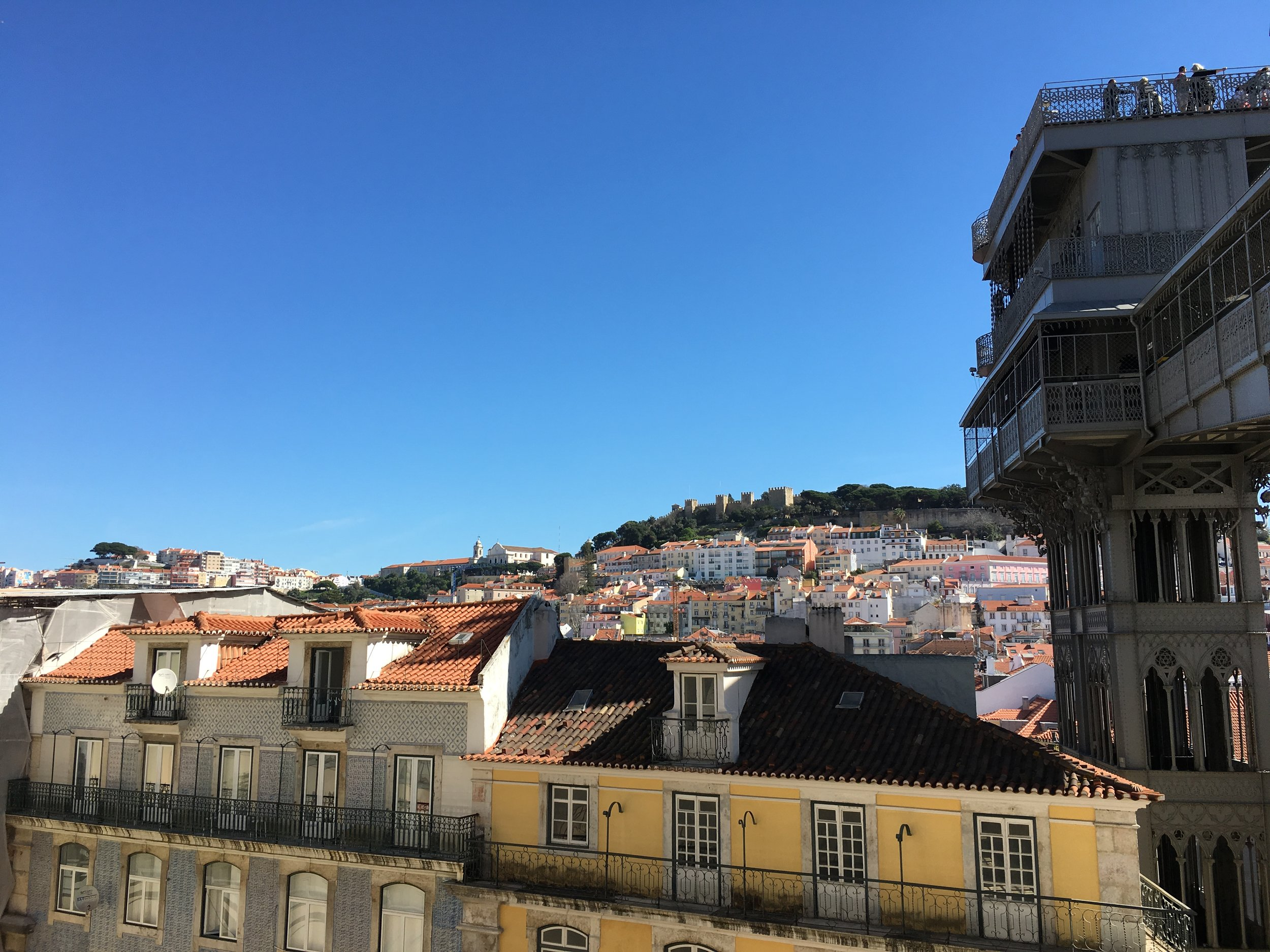 Views from Igreja do Carmo over Lisbon's tiles rooftops and the São Jorge castle. The neo-gothic lift - Elevador de Santa Justa to the right.