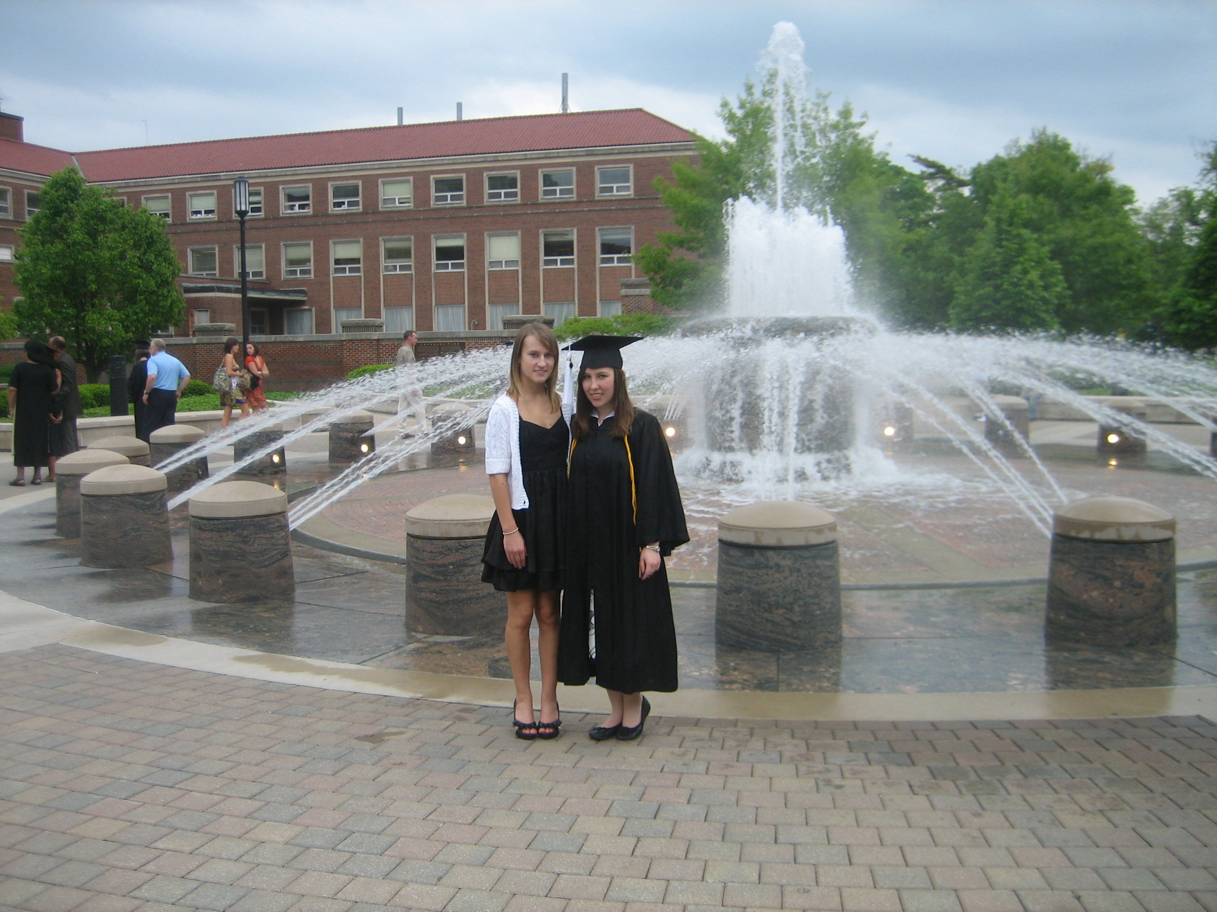 Graduation day (May 2009) with my sister in front of my favorite fountain at Purdue.