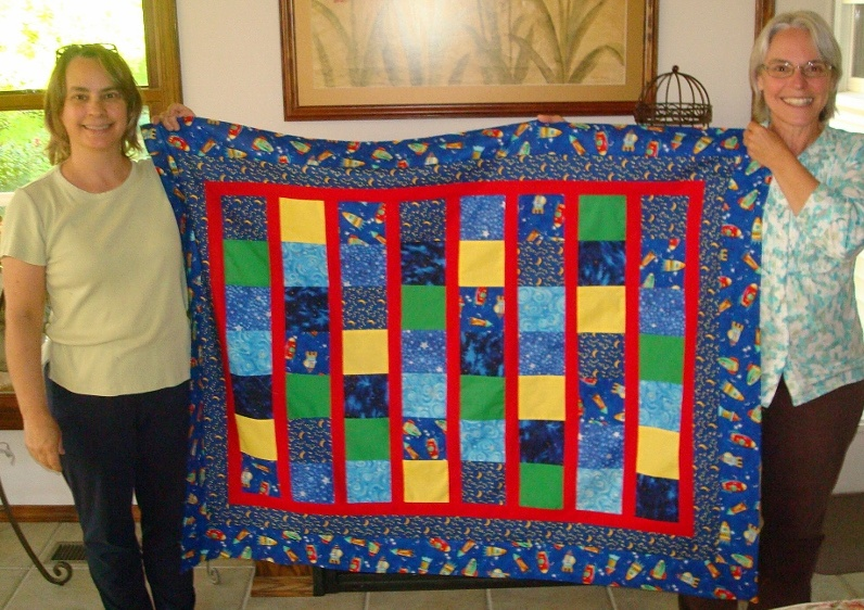 My sister Barb and I with the quilt we made for my granddaughter Adelle when she was born. She's five now and still sleeps under it.