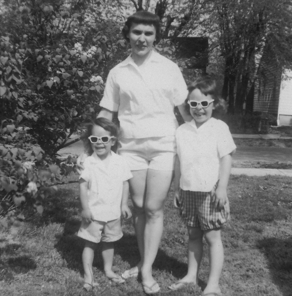 My sister Barb, our Mom, and me. Summer in our yard. West Frankfort, Illinois.