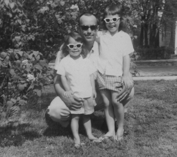 My sister Barb, our Dad, and me. Summer in our yard. West Frankfort, Illinois.
