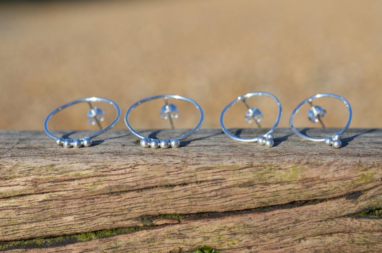 Silver large oval & circle granule studs £25