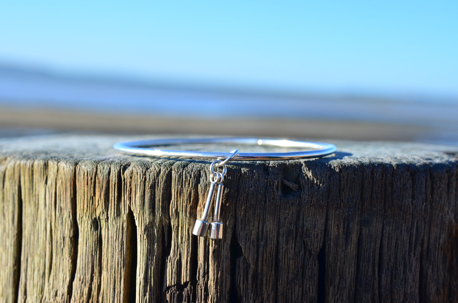Silver Bell Bangle £90