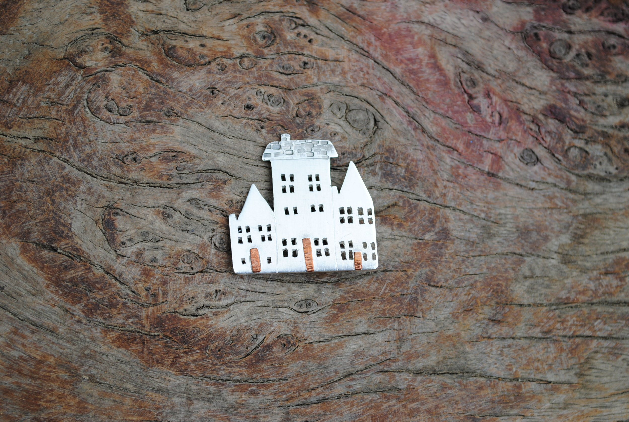 Recycled Sterling Silver, Copper and Sprung Steel Row of Three Houses Brooch. £80.