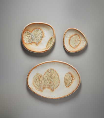 Mary Law, Persimmon Leaf  Plates, porcelain, various   sizes.   Photo: M. Lee Fatherree