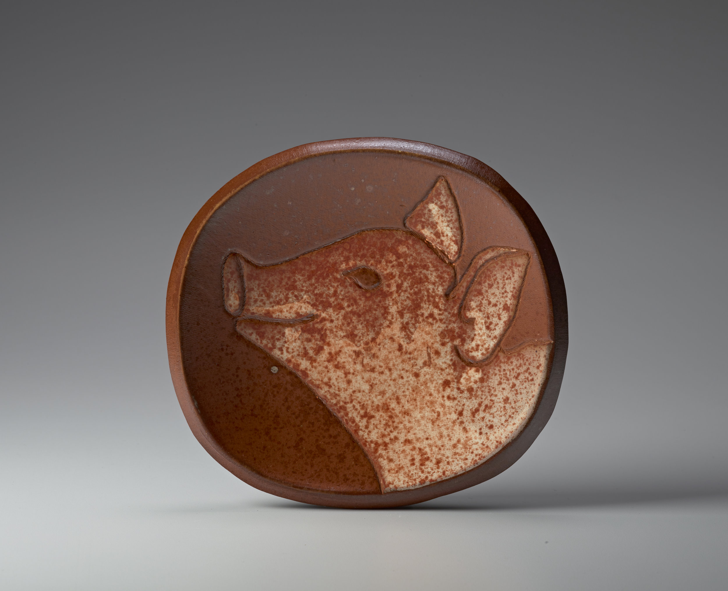 "Mary Law, Happy Pig Plate, soda-fired stoneware, 6.5"" x 7"". Photo: M. Lee Fatherree"