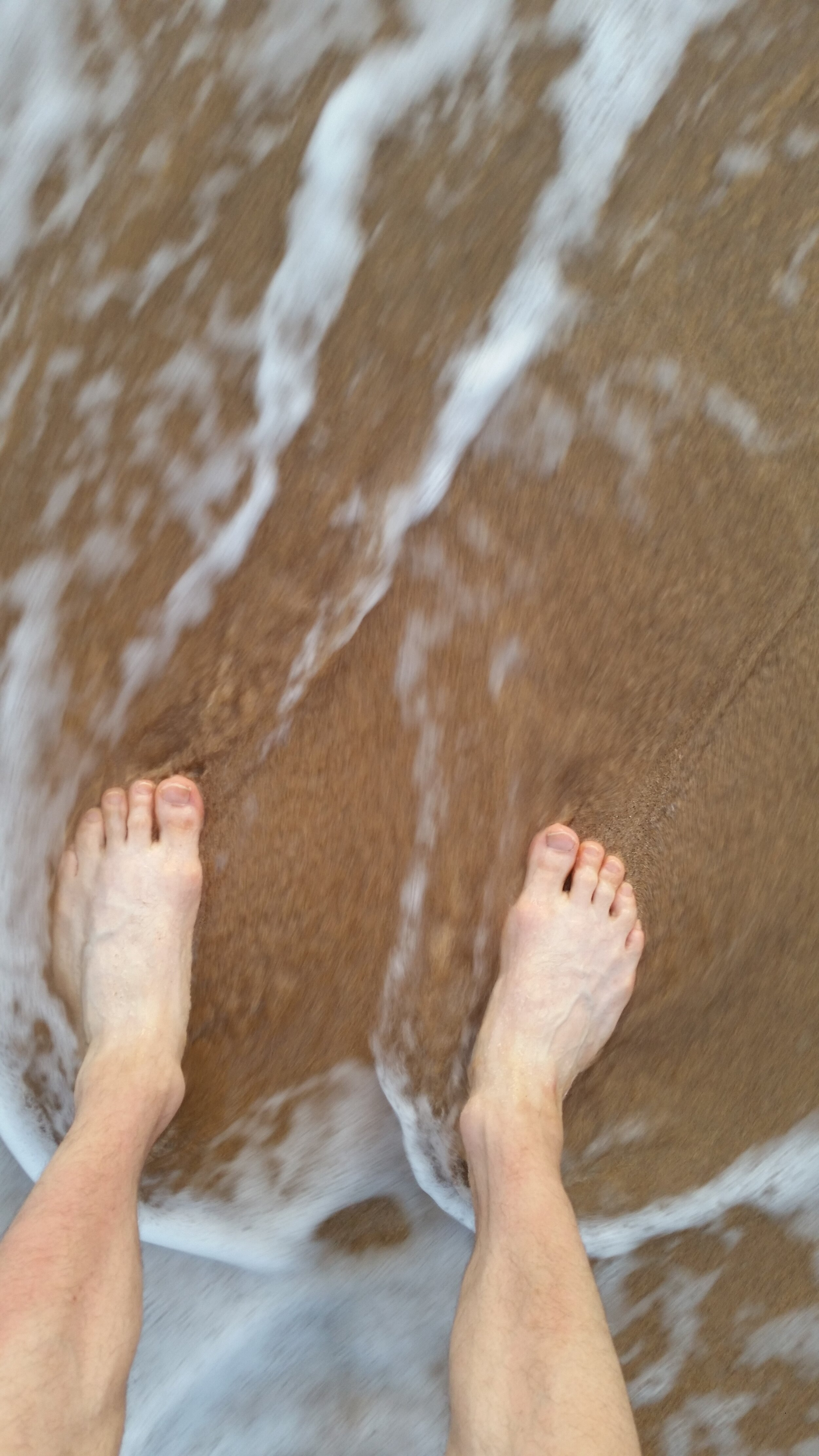 The author's feet in the sands of Kaanapali Shores.