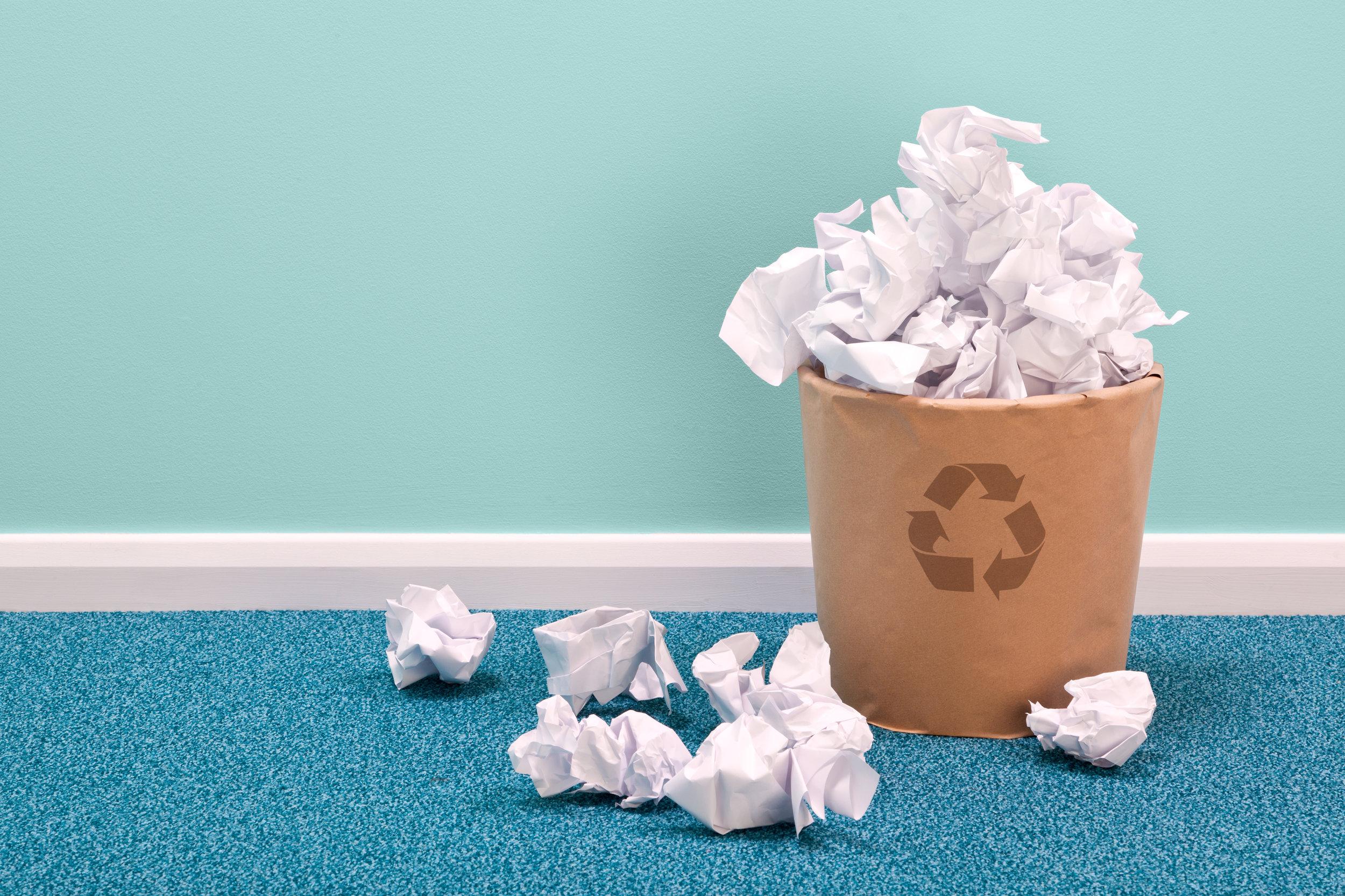 paper recycling bin on blue carpet