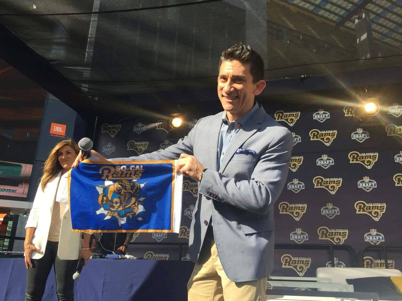 A  ndrew Siciliano  from the  NFL Network,  holding our So Cal Rams Booster Club Car Flag at the LA Rams Draft Party at LA Live. (2016)
