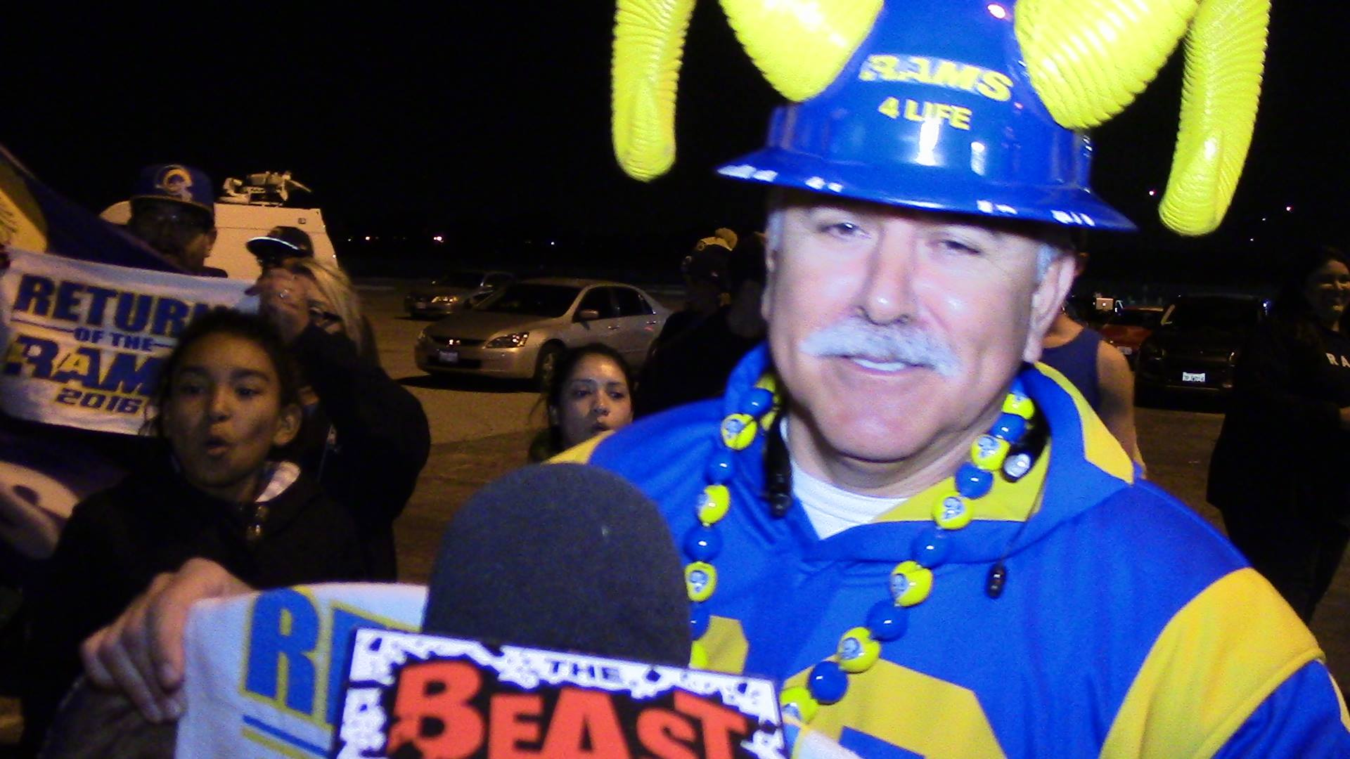 "Staff Member  Joe ""Silver Fox"" Ramirez  being interviewed by the Beast 980AM, during the Rams return to Los Angeles celebration. (2016)"
