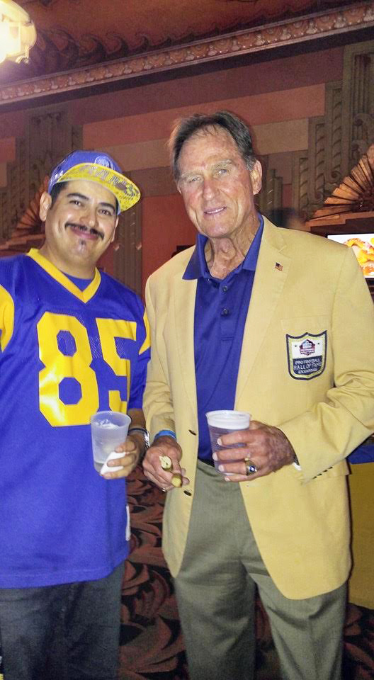 Staff Member,  Aron Gonzalez  w/ Rams HOF Legend  Jack Youngblood  at the Wiltern (2016).