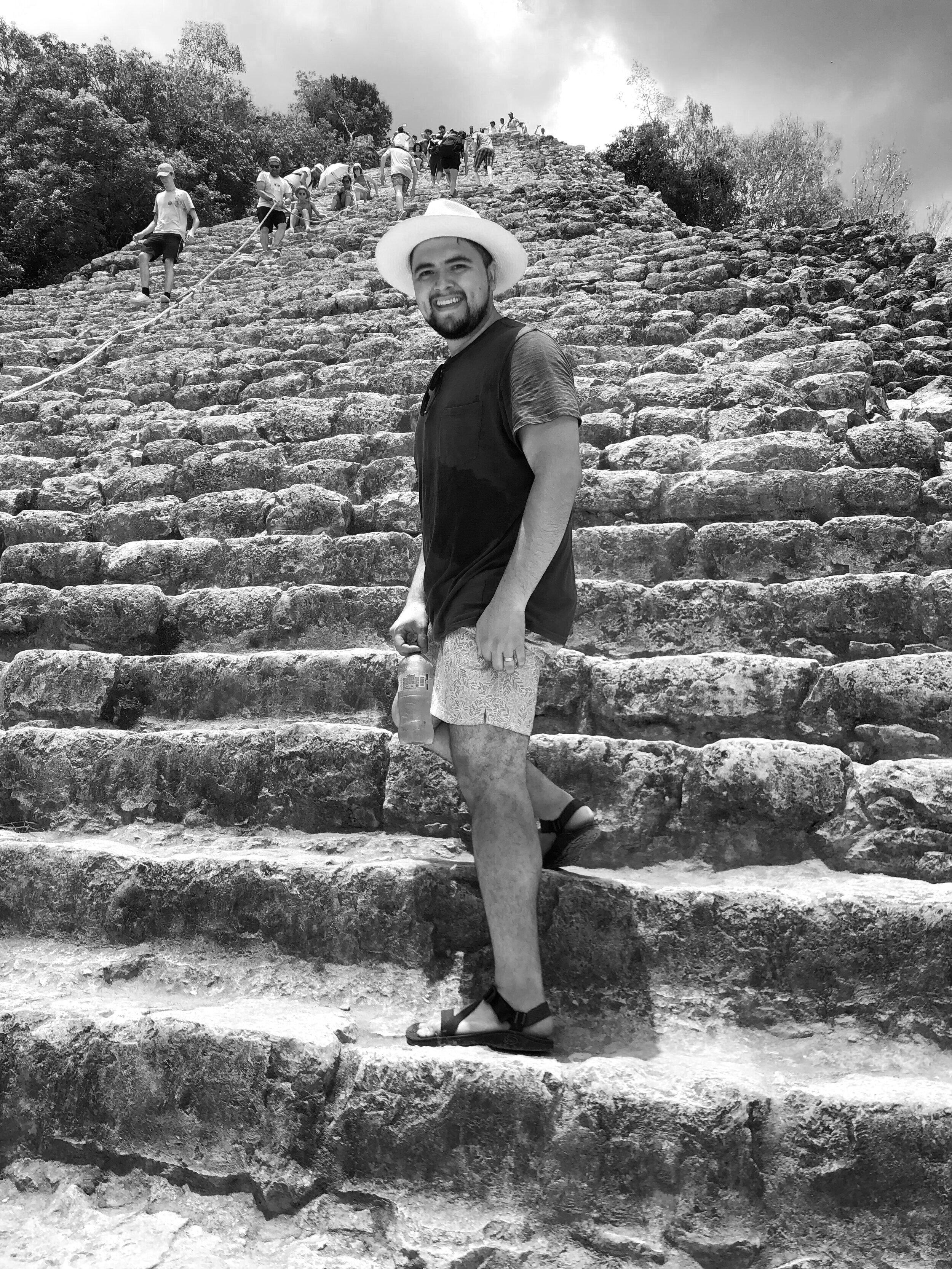 Climbing ancient pyramids with my husband, Jesús -