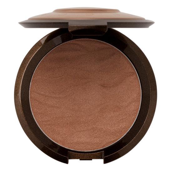 BECCA Cosmetics   Sunlit Bronzer;   $38