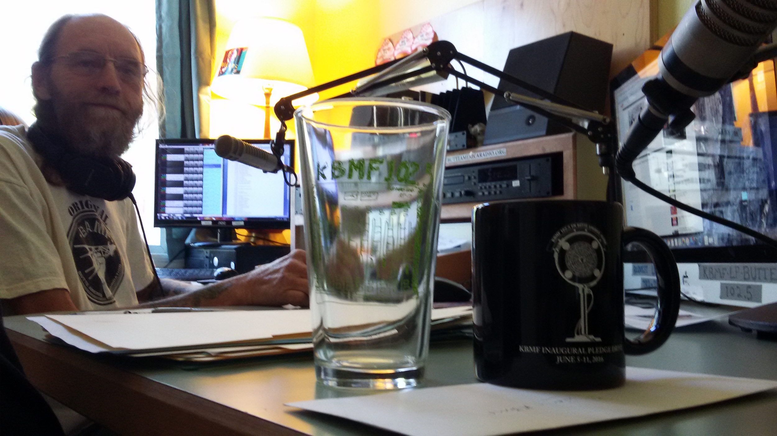 Rockin' Rodney kicks off the pledge drive with early morning music. Check out that KBMF merch!