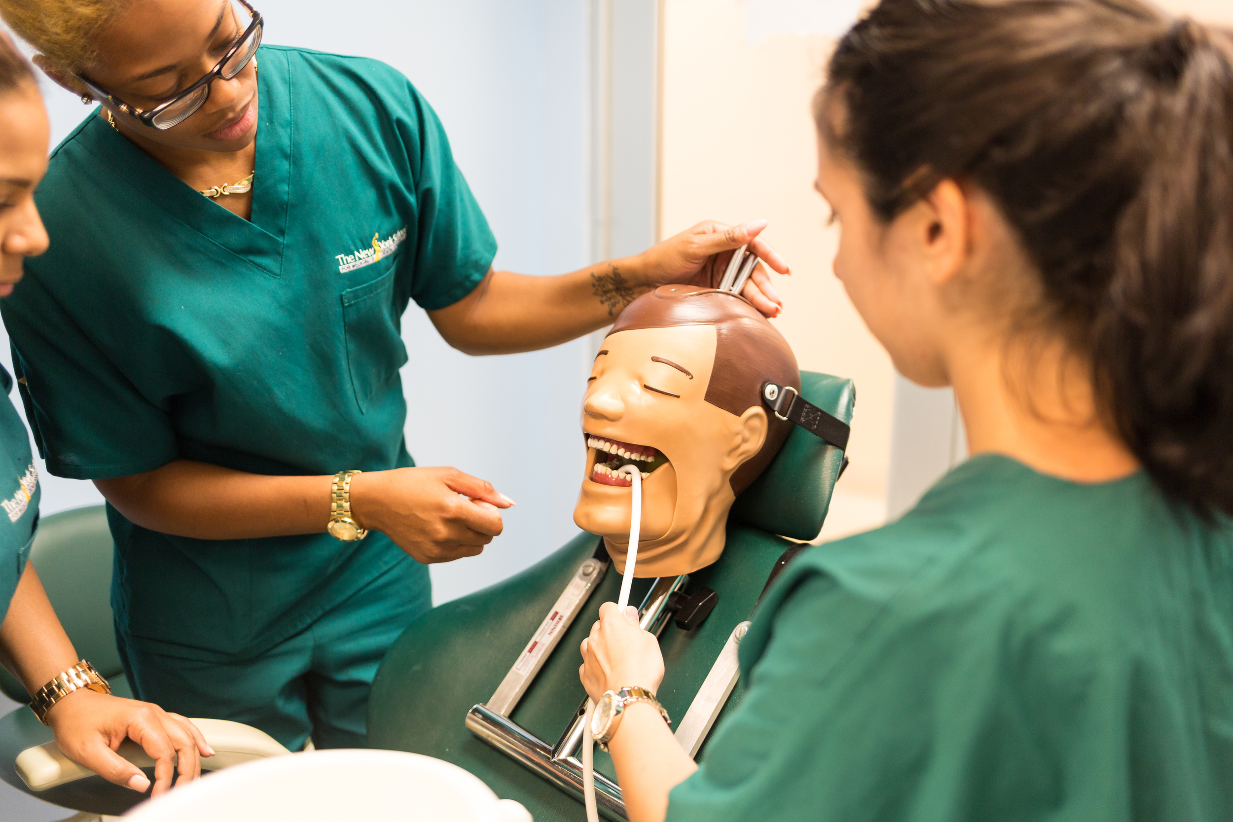 NYSMDA Dental Assistant Students practicing on Model.